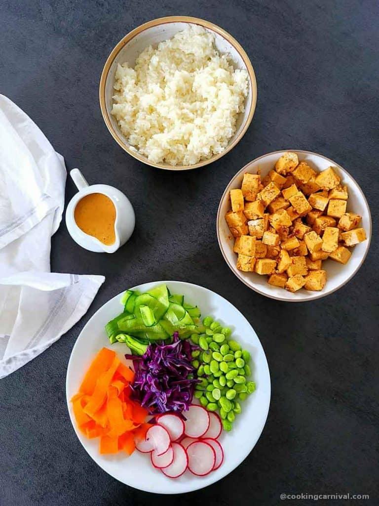 poke bowl ingredients on gray table