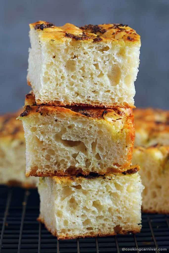 Stack of no knead pesto focaccia bread