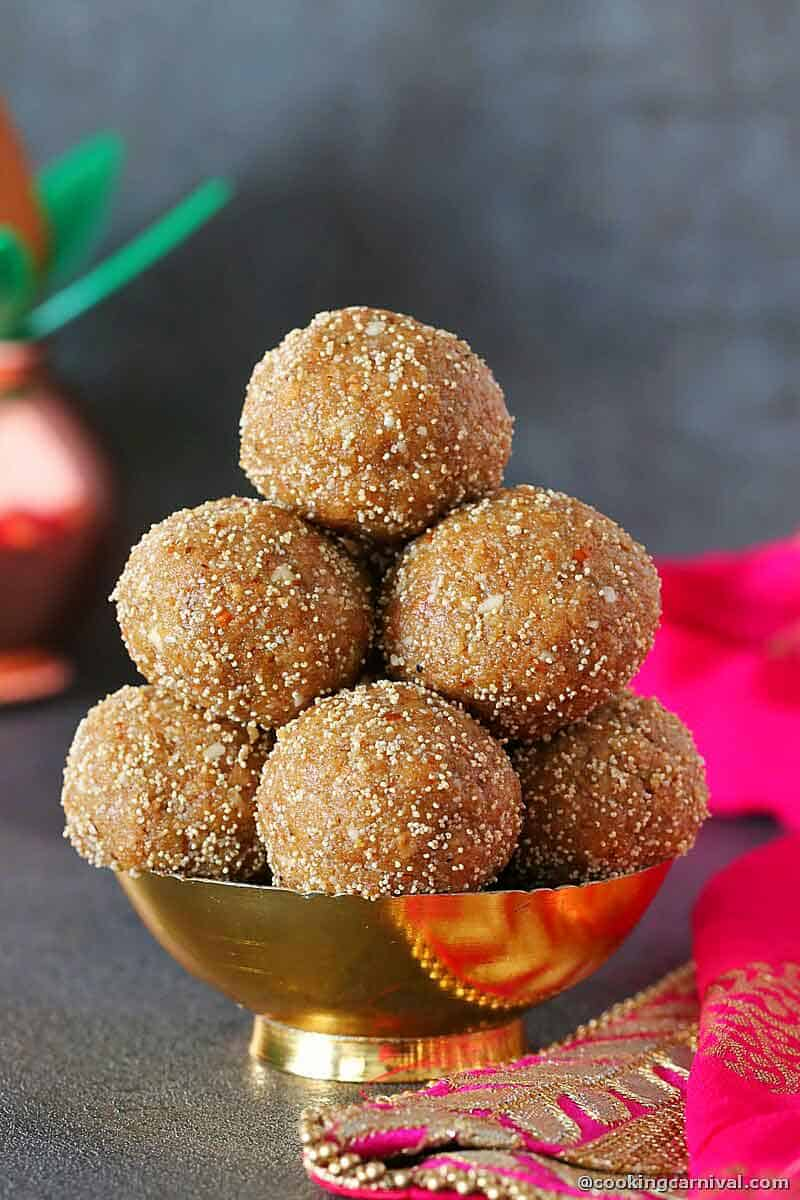 Stack of churma ladoo in a traditional bowl