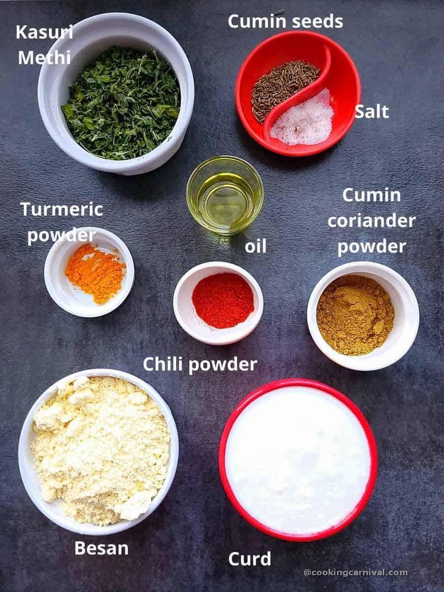Pre-measured ingredients of Methi Chana Na Lot No Ghegho on a board