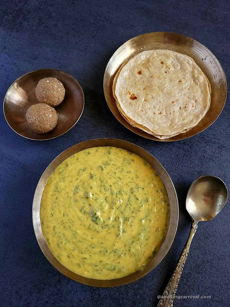 Methi Chana Na Lot No Ghegho, roti and churma ladoo on a gray table